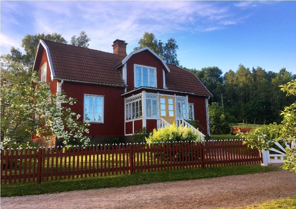 Klassisk röd villa för ren luft i hemmet